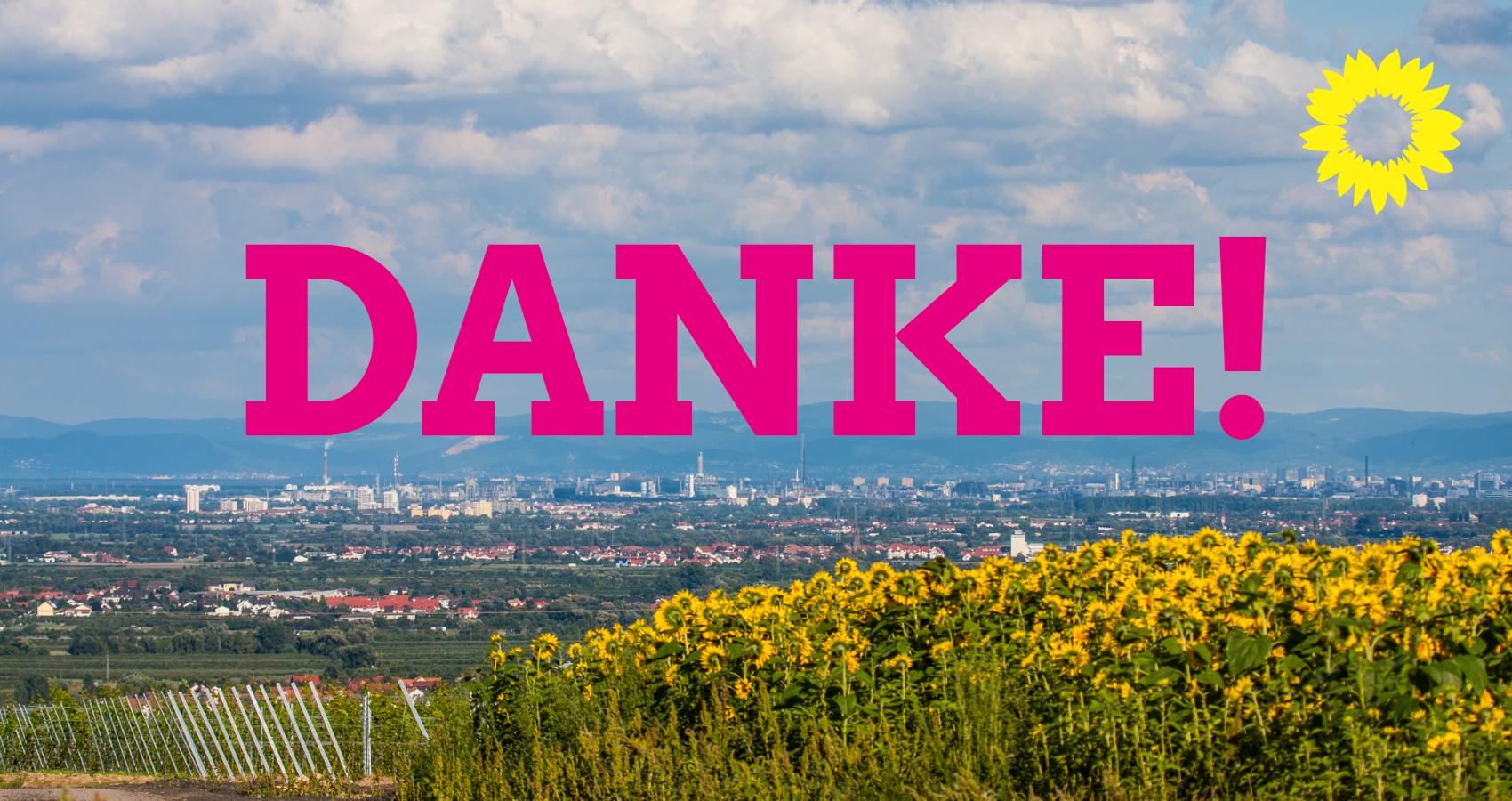 Danke! Schriftzug vor einem Foto des Rhein-Pfalz-Kreises mit Sonnenblumen.